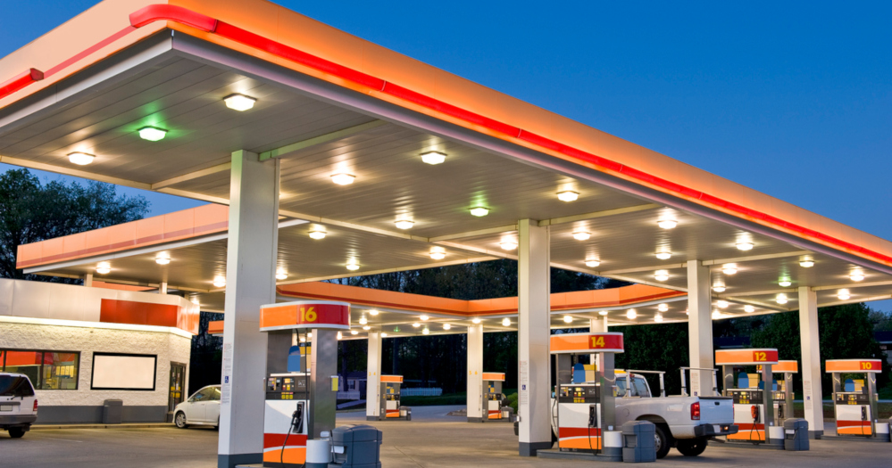 Early evening time exposure of modern retail gasoline station.  All identifying logos and trademarks have been removed, and station's original color scheme has been replaced.